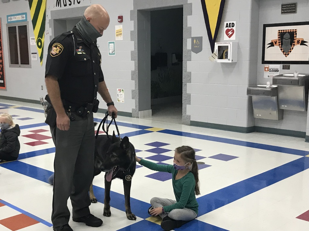 1st grade student petting K9 Charlie