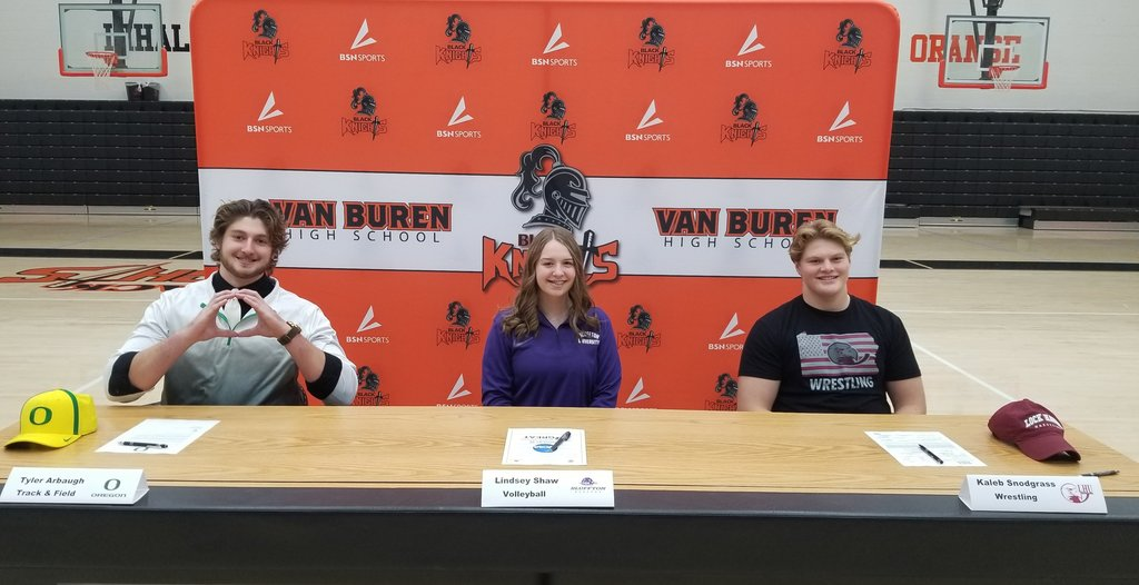 All three athletes on signing day in front of VB backdrop